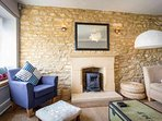 A beautiful room with exposed Cotswold stone wall, SMART TV and plenty of space to relax in