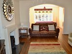 Large sitting room with original stained glass windows