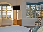 Bedroom 1 with double bed, en-suite and sea view.