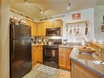 Granite counter tops, new applicances & well stocked kitchen