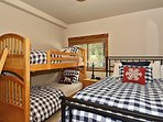 Fourth bedroom with bunks and queen located on lower level