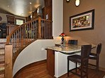 Main level wet bar with stairs leading to kitchen/dining