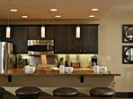 Enjoy breakfast at the kitchen bar with seating for four
