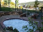 Relax after a long day in one of the two shared hot tubs