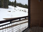 Look out to ski trails from private balcony.