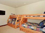 Fourth Bedroom (lower level) with two sets of twin over full bunk beds PLUS pull-out twin trundle
