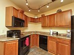Updated kitchen with modern appliances and granite countertops