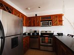 Kitchen with full size stainless steel appliances