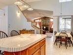 View of Kitchen Island & Dining Table , Foosball Table and Living Room