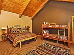 Main level fourth master with King bed, twin bunks, flatscreen TV and attached bathroom.