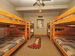 Sixth bedroom on lower level with four full-over-full beds bunk beds (sixth bathroom with hallway access)