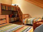 Additional upper level loft den with twin bunk plus two single twins.  Located off of loft recreation area, no door.