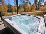 Relax in the private hot tub off the lower level patio