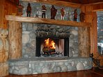 Large stone fireplace, sure to warm you in the cooler months