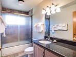 2nd bathroom on the main floor with black granite countertops and shower/bathtub combo.  The bathroom is shared by the...
