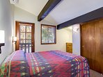 Fourth bedroom is upstairs with a queen bed and a view of the meadow beyond.