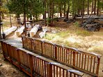 View from back deck of decorated foot bridge and tables set up in open area