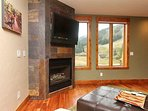 Relax and watch a movie on the flat screen TV while you cozy up by the fireplace