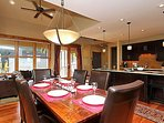Large dining table with additional bar seating