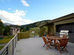 Relax on the rooftop deck and soack in the mountain views