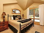 Second master bedroom on upper level with king bed