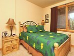 Third bedroom on lower level with queen bed