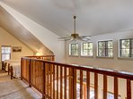 Open loft with 3 beds, bathroom, and 4th bedroom upstairs