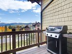 Walk out balcony with gas grill.