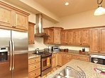 Modern kitchen with granite and stainless appliances