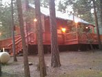 Side view of cabin, refinished deck with beautiful outdoor lighting.  Great for those summer evenings