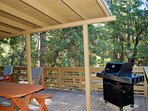 Gas grill and partially covered back deck