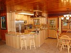Gourmet kitchen with stainless steel appliances, Wolf Range, granite counter tops