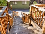 Stairs leading up to the front entrance of the cabin