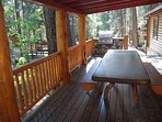 Partially covered deck with custom made picnic table, gas grill