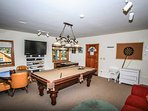 Separate Game Room Packed With A Pool Table, Foosball, Darts, Game Table Etc