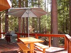 Side deck with gas grill, umbrella and picnic table
