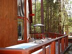 Front of cabin with two person hot tub, overlooks a seasonal stream