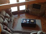 Large living room with gas log fireplace.  View from Loft
