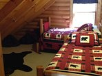 Kids bedroom upstairs.  Full size and Twin Bed.  13' TV with CD player.  Lots of CDs and games