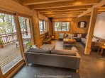 Stunning living area with log burner and great views out over the balcony