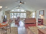 Large windows illuminate the inviting living space.