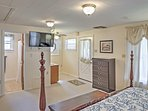 You'll find another flat-screen cable TV in the master bedroom!