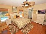 Master bedroom with queen bed, flatscreen TV and en-suite bathroom
