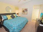 Master bedroom 2 with king bed, pool door and flatscreen TV