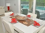 Casual dining table with pool view