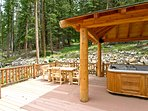 Ten person hot tub surrounded by forest