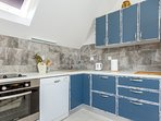 Kitchen - includes dishwasher, oven, hob, coffee maker, toaster, electric kettle, fridge and freezer