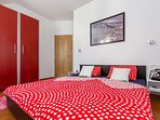 The bedroom with a king-size bed, size 2m x 1,80m for two persons.