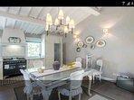 Cucina realizzata da artigiani  Fiorentini Legno massello ricoperto dal marmo di carrara.