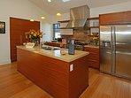 Gourmet kitchen is sleek and efficient
